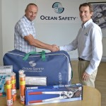 Collecting safety equipment from Mark Hart at Ocean Safety